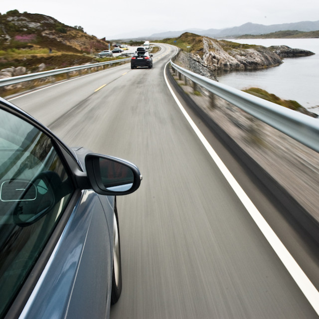 """""""car driving the Norwegian national road 64 known as the Atlantic road"""" stock image"""