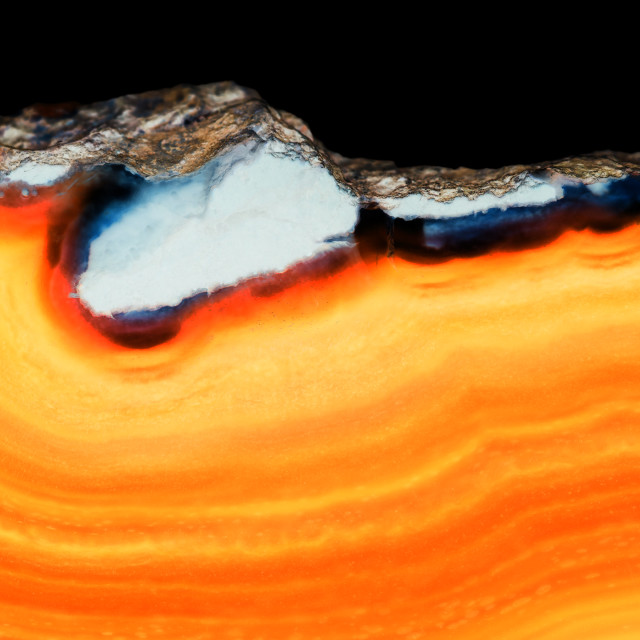 """Abstract background - orange agate mineral cross section"" stock image"