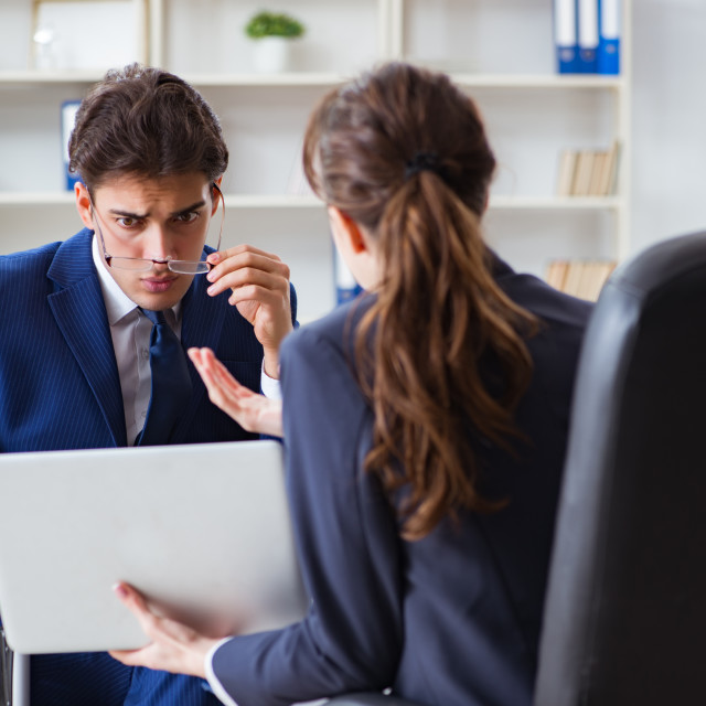 """""""Disabled businessman having discussion with female colleague"""" stock image"""