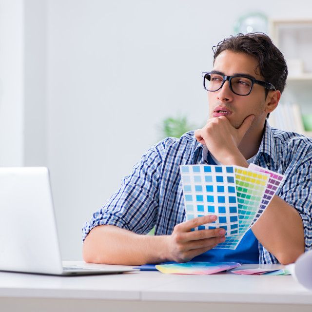 """""""Young designer working on new project and choosing colours"""" stock image"""