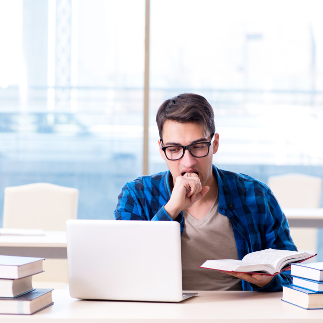 """""""Student in telelearning distance learning concept reading in lib"""" stock image"""