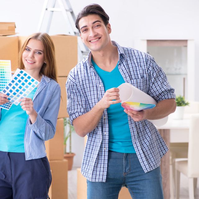 """""""Young family planning home DIY renovation with drawing"""" stock image"""