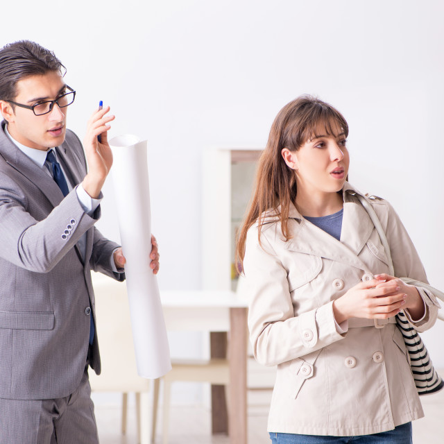 """""""Real estate agent showing new apartment property to client"""" stock image"""