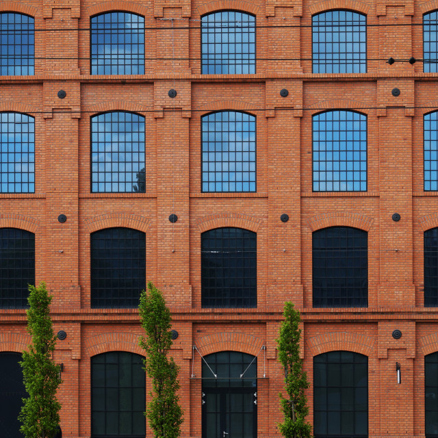 """""""A red brick wall, a revitalized building of a former factory."""" stock image"""
