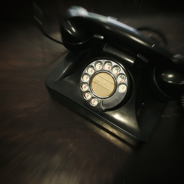 """""""Antique dial telephone with motion blurred effect with concept back to the history"""" stock image"""