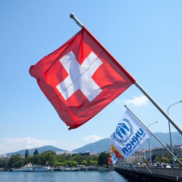 """GENEVA, SWITZERLAND - JUNE 19, 2017: Swiss flag and UNHCR flags near leman..."" stock image"