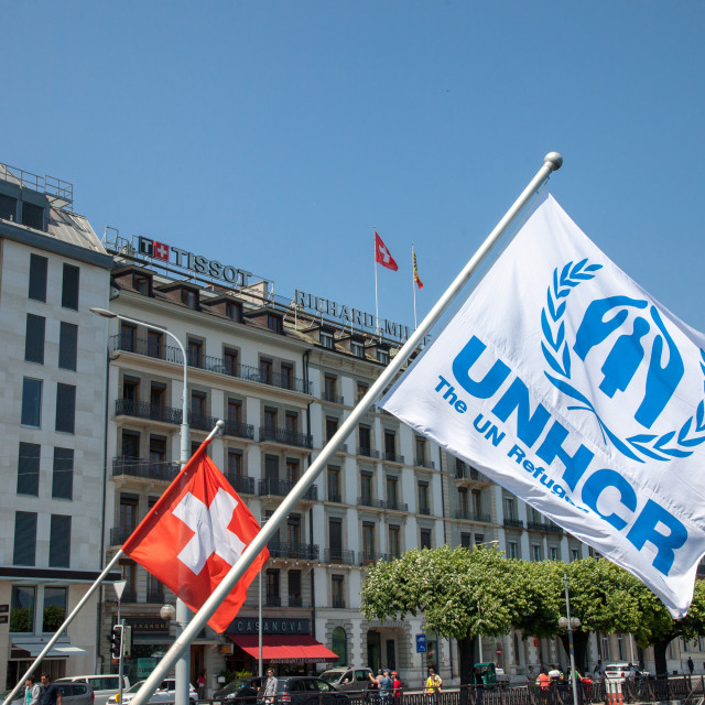 """GENEVA, SWITZERLAND - JUNE 19, 2017: Swiss flag and UNHCR flags near leman..."" stock image"
