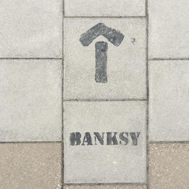 """Banksy this way"" stock image"