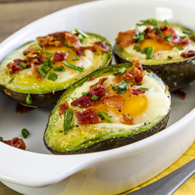 """""""Baked avocados and eggs with bacon and chives"""" stock image"""