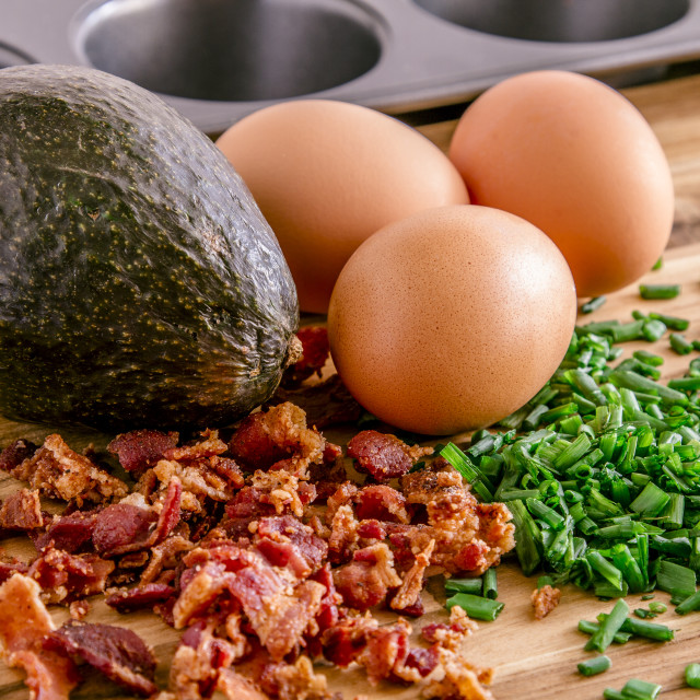 """Baked avocados and eggs with bacon and chives"" stock image"
