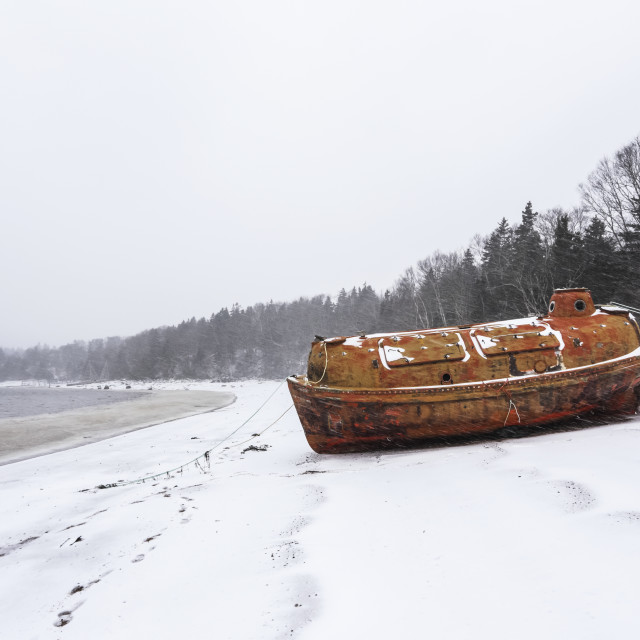 """""""An old emergency life-boat safety vessel on the snowy shore in Sandy Cove..."""" stock image"""