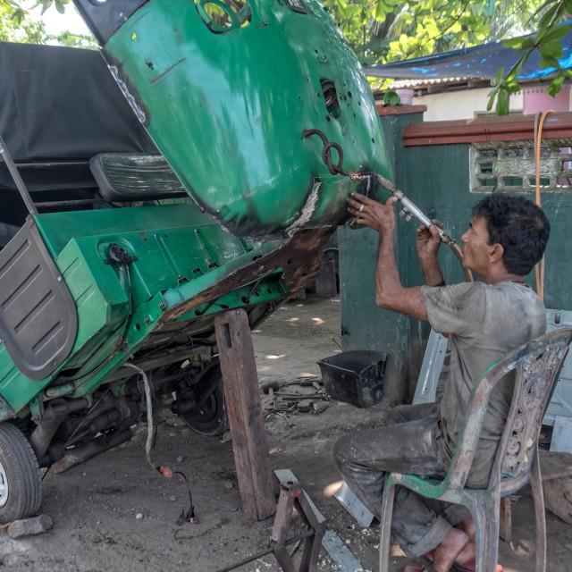 """""""Repair of a tuk-tuk"""" stock image"""