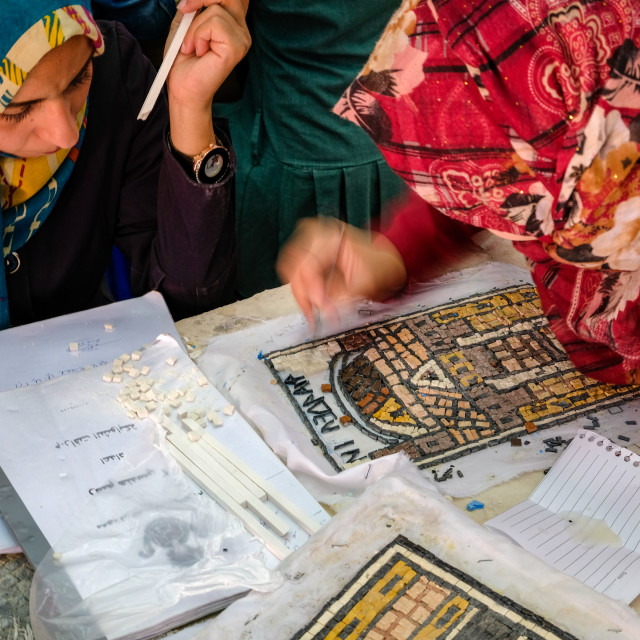 """Student with a headscarf make a colorful mosaic in Madaba"" stock image"