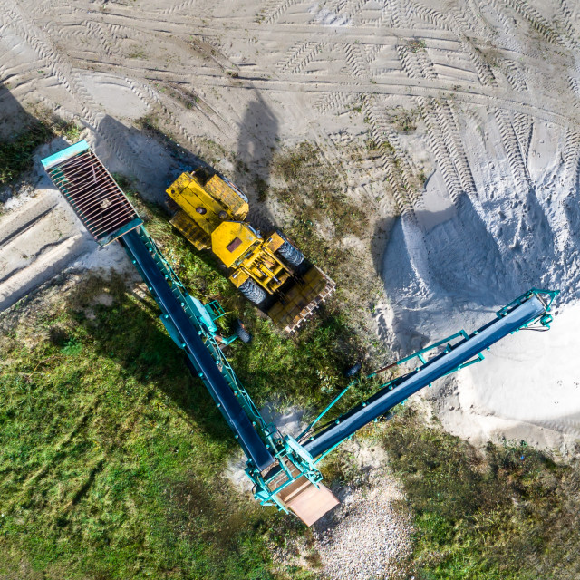 """""""Large machine for screening sand and bulldozer, vertical aerial"""" stock image"""