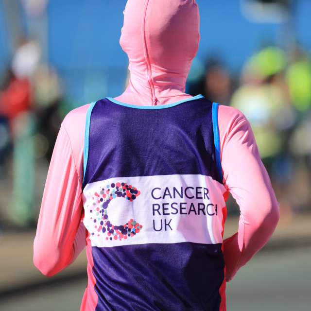 """Runner for Cancer Research in the Brighton Marathon"" stock image"