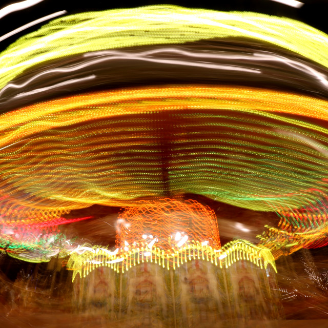 """Abstract view of a Merry-go-round at night"" stock image"