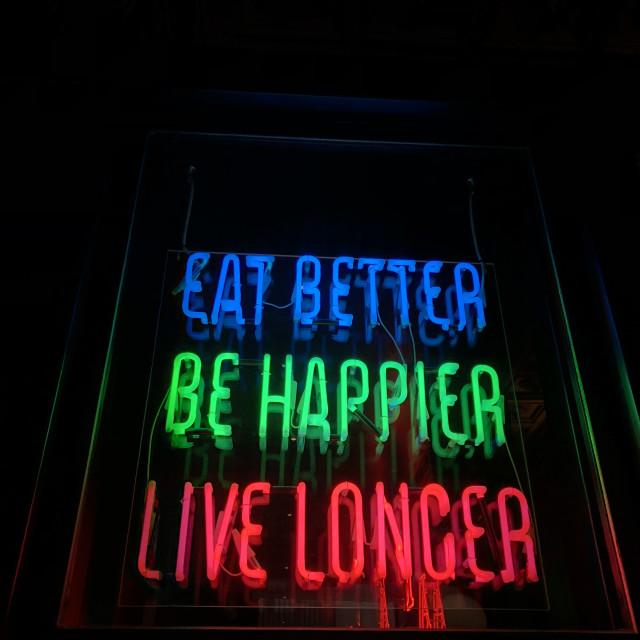 """""""Eat better, be happier, live longer"""" stock image"""