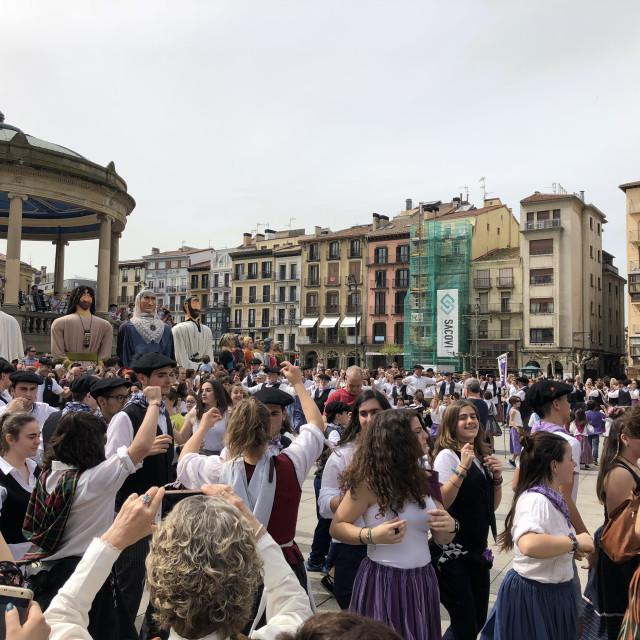 """People walking and dancing at plaza del castillo in Pamplona, Navarra, Spain"" stock image"