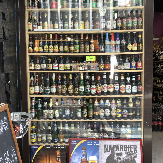 """""""A shopwindow of a beer shop full of different brands of beer in Pamplona, Spain"""" stock image"""