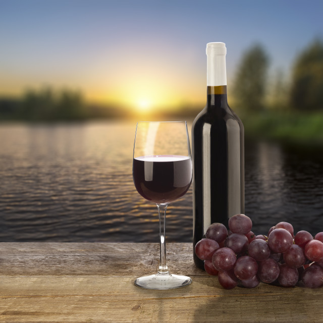 """""""Red wine bottle, grape and glasses"""" stock image"""