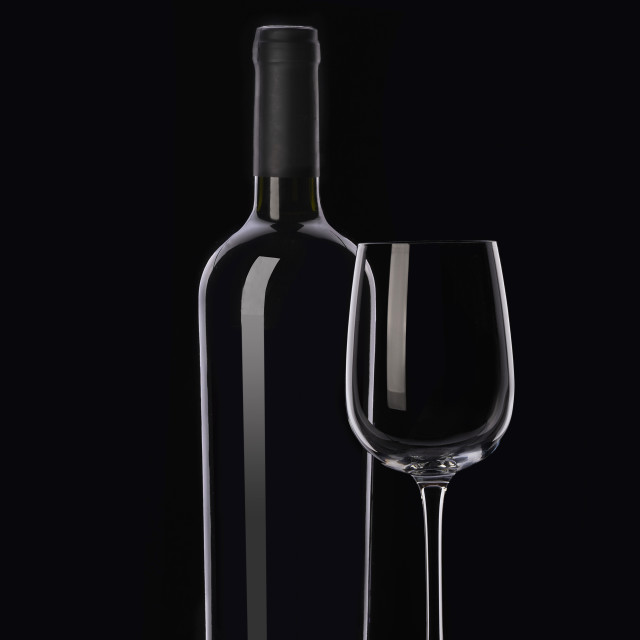 """""""Red wine bottle and glasses on black background"""" stock image"""