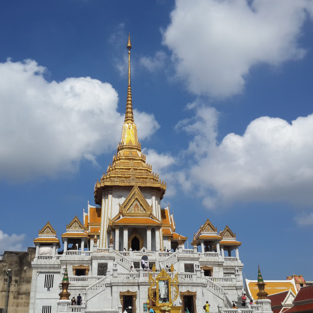 """""""The Temple of the Golden Buddha soars into cloudy sky"""" stock image"""