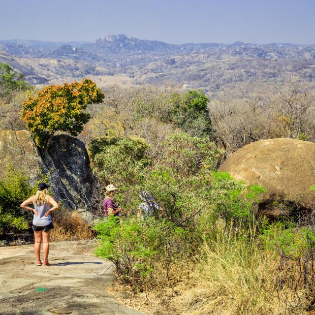 """Tourists walking among the rocks in Matobo National Park, Zimbabwe."" stock image"