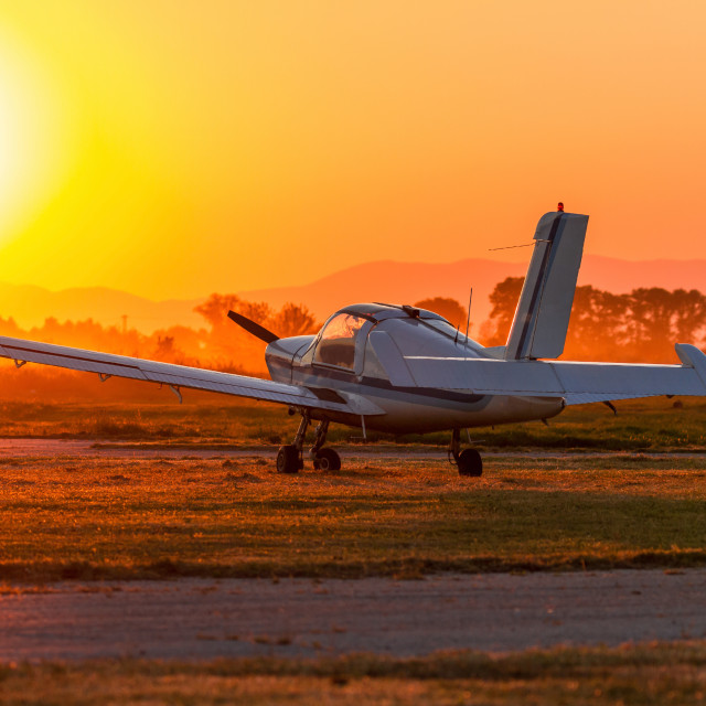 """Airplane on the airfield runway"" stock image"
