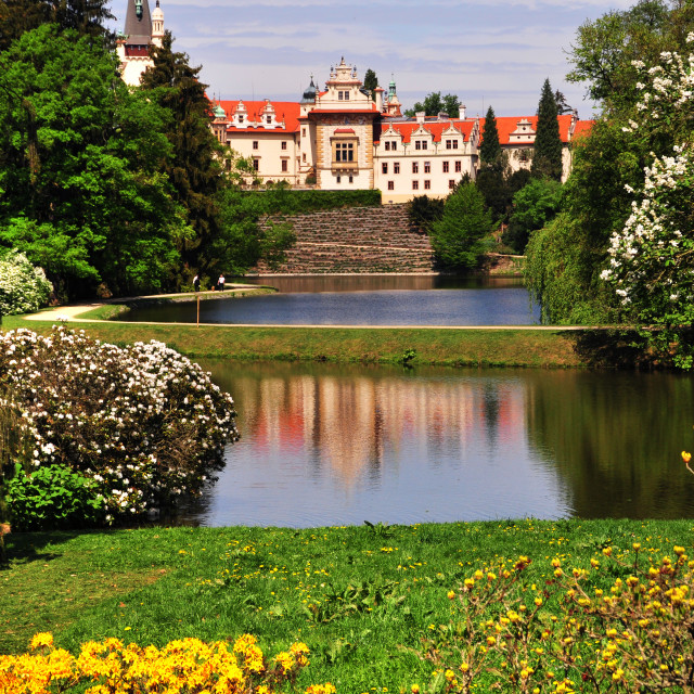 """""""Pruhonice park with castle reflecting in lake in spring"""" stock image"""
