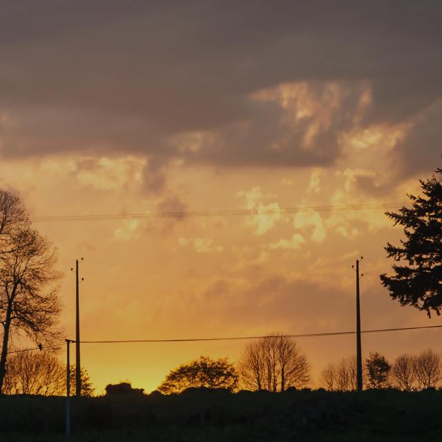 """Sunset over farmland"" stock image"