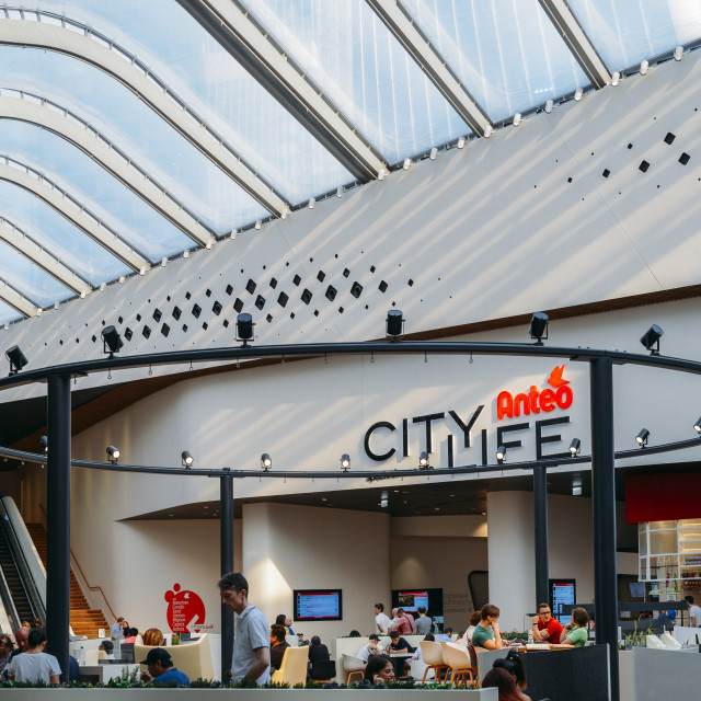 """Shoppers at the food court at the modern City Life shopping centre"" stock image"
