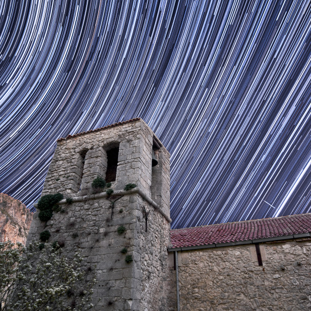 """Old bell tower in star trails."" stock image"