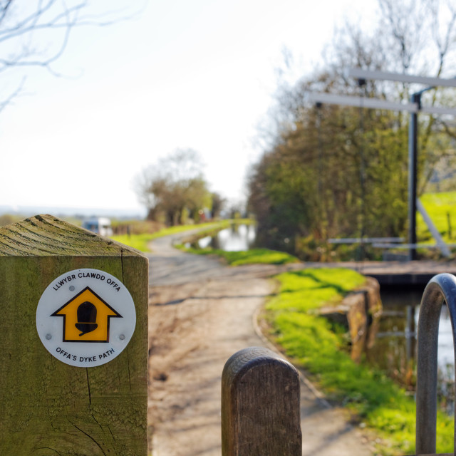 """""""Offa's Dyke Sign Post and lift bridge on Montgomery Canal, Powys, Wales"""" stock image"""