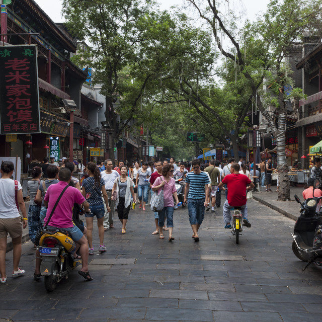"""Xian, China - August 5, 2012: Street scene in the Muslim Quarter of the city of Xian, with people walking in a street, in China, Asia"" stock image"