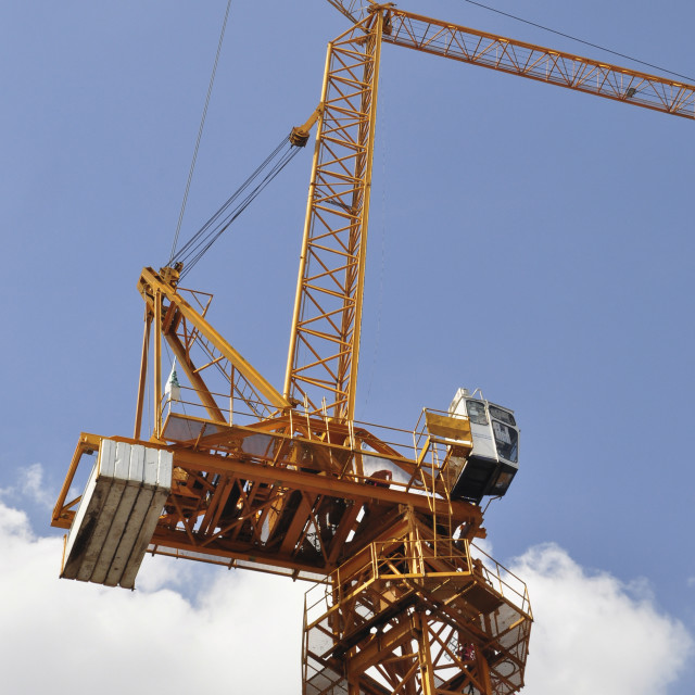 """""""Luffing jib tower crane soars into blue sky"""" stock image"""
