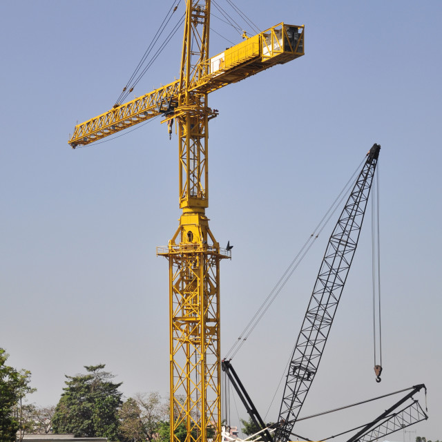 """""""Tower crane at construction site near river"""" stock image"""