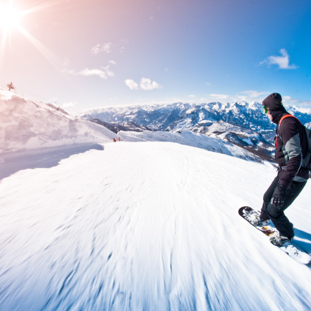 """snowboarder riding fast, motion blur, fisheye shot"" stock image"