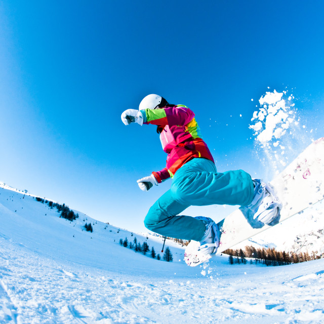 """""""girl snowboarder havong great fun jumping"""" stock image"""