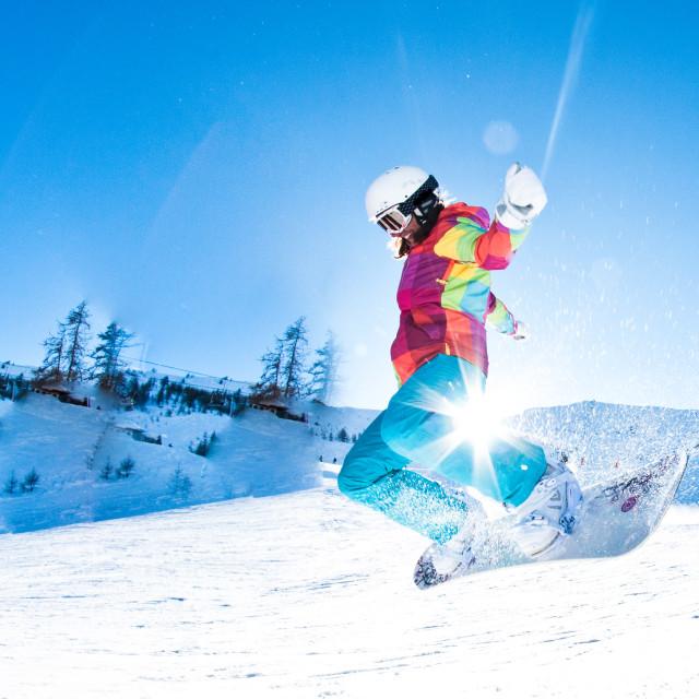 """girl snowboarder having great fun jumping"" stock image"