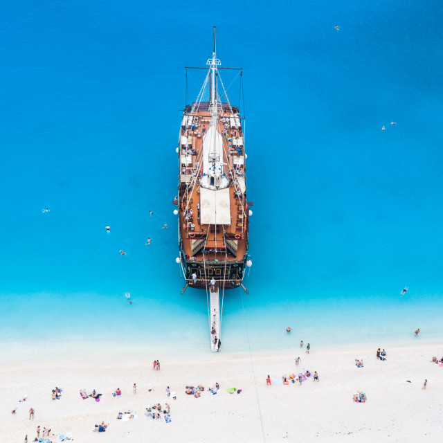 """large sail cruise ship anchored at white sand beach, seen from above"" stock image"
