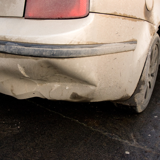 """dirty white car with smashed bumper"" stock image"