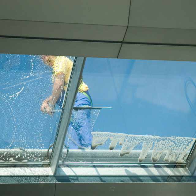 """worker cleaning windows"" stock image"