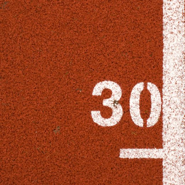 """""30"" mark on running track"" stock image"