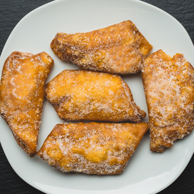 """""""Typical spanish sweets, Fritters with sugar or pestinos"""" stock image"""