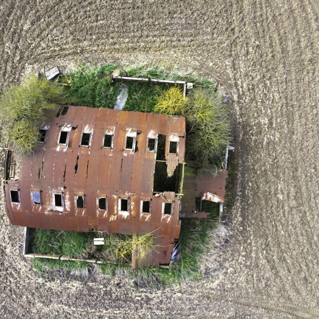 """Aerial view of an old barn on farmland"" stock image"