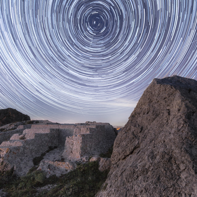 """Ancient sacrificial altar in Sicily in star trails."" stock image"