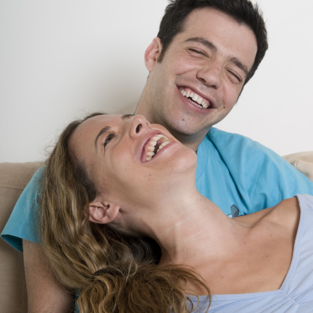 """A young couple in their 20s enjoying an intimate moment"" stock image"