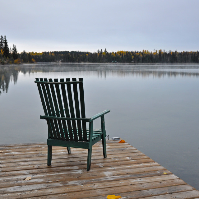 """""""Empty chair on autumn morning lakside"""" stock image"""