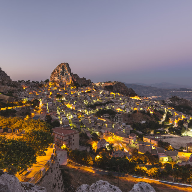 """Sicilian mountain top village at blue hour."" stock image"