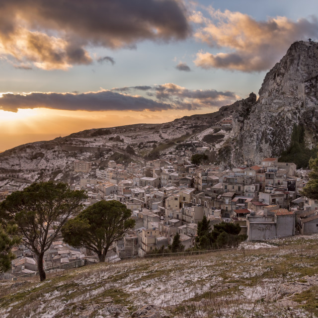"""""""Sicilian mountain top village with snow at sunset and clouds."""" stock image"""